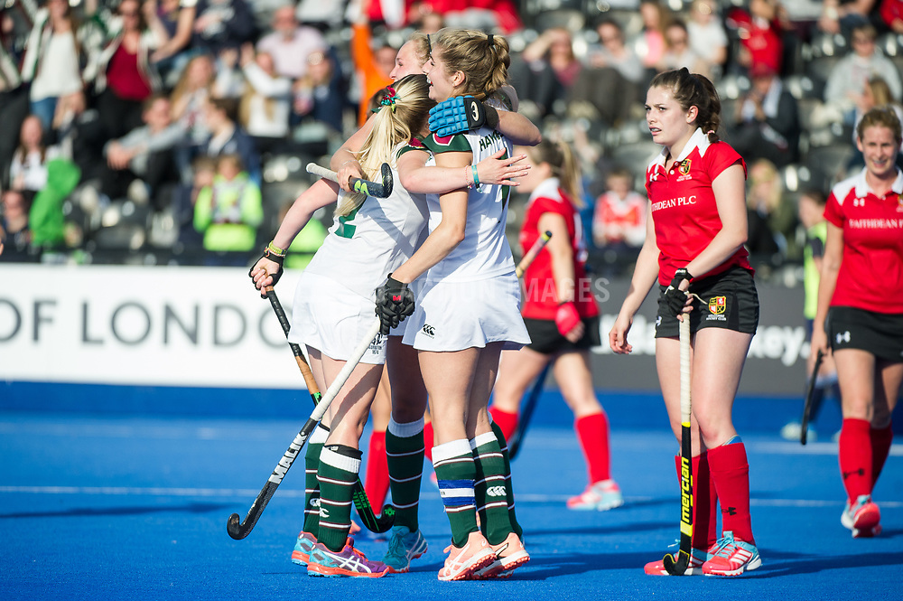 Surbiton celebrate scoring their second goal. Holcombe v Surbiton - Investec Women's Hockey League Final, Lee Valley Hockey & Tennis Centre, London, UK on 23 April 2017. Photo: Simon Parker