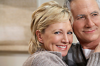 Portrait mature couple hugging close-up