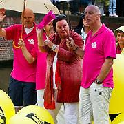 NLD/Amsterdam/20100807 - Boten tijdens de Canal Parade 2010 door de Amsterdamse grachten. De jaarlijkse boottocht sluit traditiegetrouw de Gay Pride af. Thema van de botenparade was dit jaar Celebrate, FNV voorzitter Agnes Jongerius