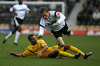 Photo: Pete Lorence.<br />Derby County v Bristol Rovers. The FA Cup. 27/01/2007.<br />Seth Johnson is sent flying by Aaron Lescott.
