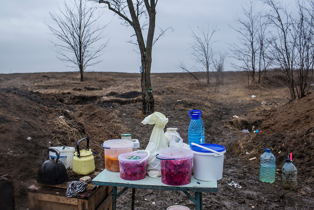 A table sits outside in the rain and mud at a front-line encampment manned by the St. Mary's Battalion, a pro-Ukraine militia, on February 5, 2015 in Talakivka, Ukraine. With more than 220 people having died in the past several weeks, a new diplomatic push is underway to bring an end to fighting between pro-Russia rebels and Ukrainian forces.