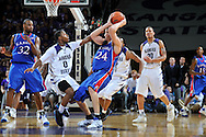 Jan 30, 2008; Manhattan, KS, USA; Kansas State Wildcats guard Jacob Pullen (0) pressures Kansas Jayhawks forward Sasha Kaun (24) in the second half at Bramlage Coliseum in Manhattan, KS. Kansas State upset the 2nd ranked Kansas Jayhawks 84-75. Mandatory Credit: Peter G. Aiken-US PRESSWIRE