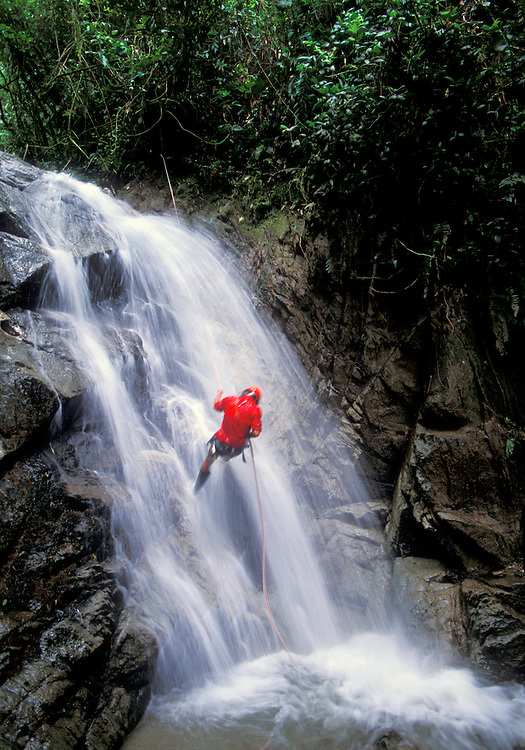 An adventurer repels down one of the many waterfalls of the rugged rivers that descend the Ecuadorian Andes into the jungle flatlands known as El Oriente.
