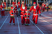 A family arrives for the start on a very frosty track - 2000 Santas of all ages take part in the annual Santa Run in Battersea Park to support Noah's Ark Children's Hospice.