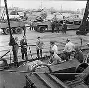"""31/07/1962<br /> 07/31/1962<br /> 31 July 1962<br /> Oil drilling equipment arrives at North Wall, Dublin. Image shows unloading of oil drilling machinery for Ambassador Irish oil. View shows equipment on CIE heavy haulage truck while executives talk to the deck crew of the """"Kendall""""."""