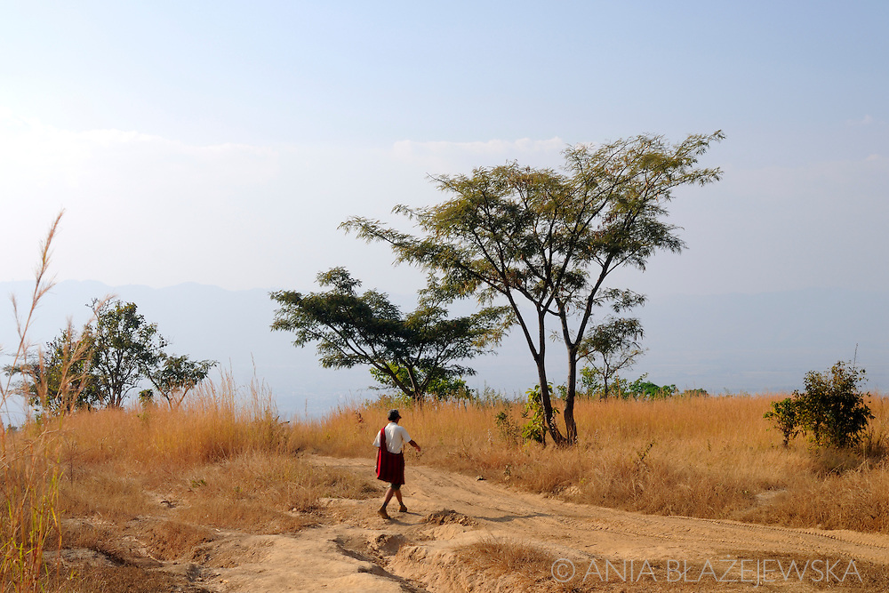 Myanmar/Burma. Man walking the mountain road in the eastern part of Myanmar.