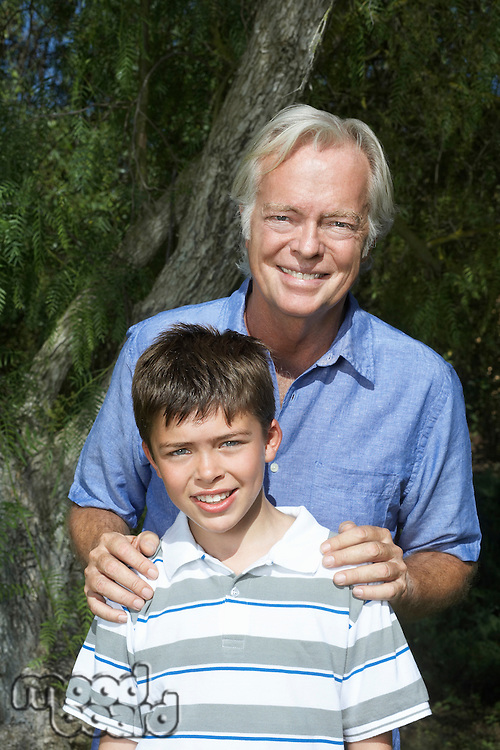 Portrait of grandfather with boy (10-12)