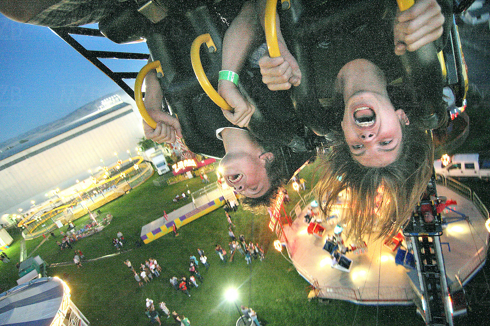 "(fired-up-side-down)  --  Screams, smiles and hair fly as Tabor Wyckoff (left), 13, and Austin Casey, 14, experience the looping ride ""Fire Ball"" at this year's carnival for the Walla Walla Fair and Frontier Days.        Thursday, August 28, 2008        MZ Photo"