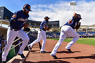 PHOENIX, AZ - MARCH 04:  Domingo Santana #16, Hernan Perez #14 and Eric Thames #7 of the Milwaukee Brewers take the field for the spring training game against the Texas Rangers at Maryvale Baseball Park on March 4, 2017 in Phoenix, Arizona.  (Photo by Jennifer Stewart/Getty Images)
