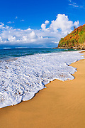 Sand and surf at Hanakapiai Beach along the Kalalau Trail, Na Pali Coast, Kauai, Hawaii USA