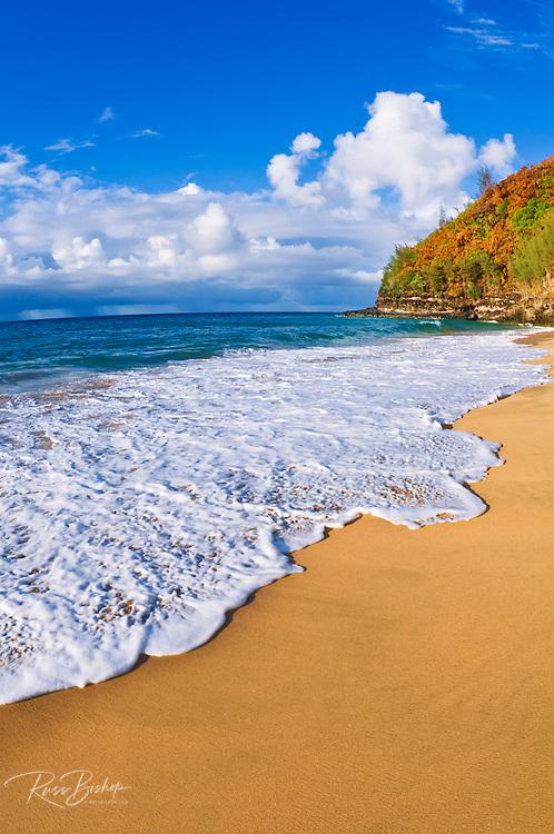 Sand and surf at Hanakapiai Beach along the Kalalau Trail, Na Pali Coast, Kauai, Hawaii USA