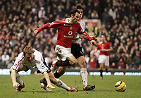 Photo: Paul Thomas.<br />Manchester United v Liverpool. The Barclays Premiership. 22/01/2006.<br /><br />Man Utd's Ryan Giggs goes past John Arne Riise and Xavi Alonso