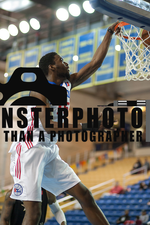 Delaware 87ers Forward Norvel Pelle (15) dunks the ball with authority in the first half of a NBA D-league regular season basketball game between the Delaware 87ers (76ers) and the Erie BayHawks (Knicks) Monday, Jan 13, 2014 at The Bob Carpenter Sports Convocation Center, Newark, DE