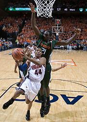 Virginia Cavaliers point guard Sean Singletary (44) heads to the basket against Miami Hurricanes forward Dwayne Collins (21).  The University of Virginia Cavaliers defeated the Miami Hurricanes Men's Basketball Team 81-70 at the John Paul Jones Arena in Charlottesville, VA on February 3, 2007.