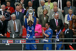 LONDON, ENGLAND - Saturday, May 17, 2008: Portsmouth's match-winner Nwankwo Kanu lifts the trophy as his team-mates celebrate winning the cup after beating Cardiff City 1-0 during the FA Cup Final at Wembley Stadium. (Photo by Chris Ratcliffe/Propaganda)