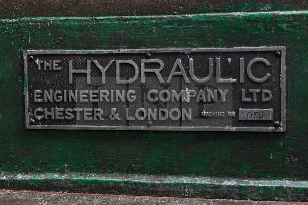© Licensed to London News Pictures. 01/12/2013. London, UK. Image date: 28 August 2012. A Hydraulic Engineering Company sign on equipment inside the Wapping Project restaurant (formerly the Wapping Hydraulic Power Station). The Wapping Project restaurant and art space will close at the end of 2013. Photo credit : Vickie Flores/LNP