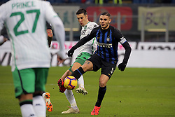 January 19, 2019 - Milan, Milan, Italy - Mauro Icardi #9 of FC Internazionale Milano competes for the ball with Federico Peluso #13 of US Sassuolo during the serie A match between FC Internazionale and US Sassuolo at Stadio Giuseppe Meazza on January 19, 2019 in Milan, Italy. (Credit Image: © Giuseppe Cottini/NurPhoto via ZUMA Press)