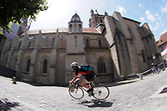 Picture by Andrew Tobin/Tobinators Ltd +44 7710 761829<br /> 04/08/2013<br /> A rider shoots past the cathedral during the Cycle Messenger World Championships held in Lausanne, Switzerland. Started in 1993 by Achim Beier from Berlin, the championships are not only a sporting contest but an opportunity to unite friends and bicycle enthusiasts worldwide. The event comprises a number of challenges including a sprint, a track stand (longest time stationary on the bike), a cargo race where heavy loads are carried on special bikes, and the main race. The course winds through central Lausanne and includes bridges, stairs, cobbles, narrow alleyways and challenging hills. The main race simulates the job of a bike courier making numerous drops and pickups across the city. Riders need to check in at specific checkpoints, hand over their delivery and get a new one. The main race can take up to 4 hours for each competitor to complete.