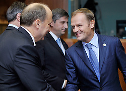Donald Tusk, Poland's prime minister, speaks with Andrius Kubilius, Lithuania's prime minister, during the European Union Summit at the EU headquarters in Brussels, Belgium, on Thursday, Oct. 29, 2009.