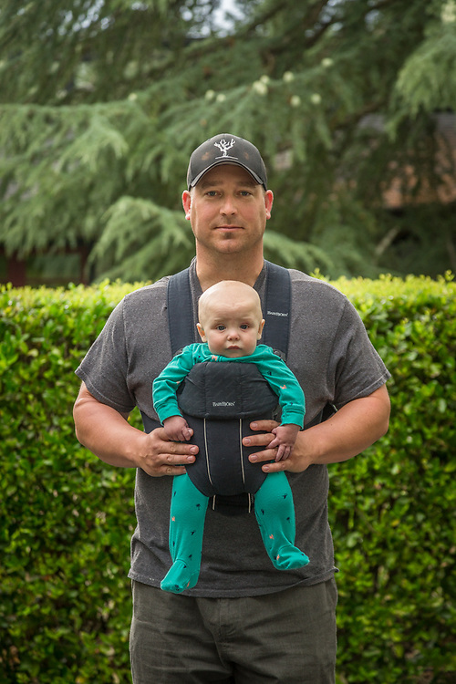 """My wife unually carries West...it's unusual for me to wear this thing.""  -Vineyard owner Brian Harlen with his six month old son, West, near their home in Calistoga"
