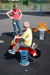 Brother and sister playing in the playground,