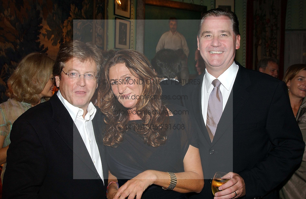 Left to right, JOHN PAWSON, KATHERINE IRELAND and     at a party for interior designer Katherine Ireland held at Marks club, 46 Charles Street, London W1 on 27th September 2004.<br /><br />NON EXCLUSIVE - WORLD RIGHTS