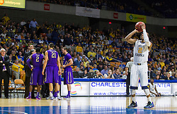 Nov 16, 2015; Charleston, WV, USA; West Virginia Mountaineers guard Jevon Carter shoots a foul shot after a technical foul was called during the first half against the James Madison Dukes at the Charleston Civic Center. Mandatory Credit: Ben Queen-USA TODAY Sports