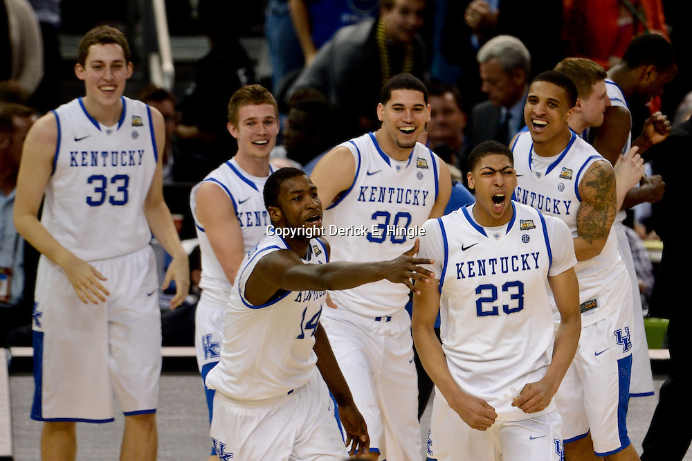 Apr 2, 2012; New Orleans, LA, USA; Kentucky Wildcats forward Anthony Davis (23) celebrates with teammates after defeating the Kansas Jayhawks 67-59 in the finals of the 2012 NCAA men's basketball Final Four at the Mercedes-Benz Superdome. Mandatory Credit: Derick E. Hingle-US PRESSWIRE