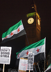 Westminster, London, December 2nd 2015.  As Parliament prepares to vote on air strikes on Islamic State terrorists in Syria, Stop The War and other groups opposed to British military involvement protest outside Parliament. PICTURED:  10 pm when the vote was called. ///FOR LICENCING CONTACT: paul@pauldaveycreative.co.uk TEL:+44 (0) 7966 016 296 or +44 (0) 20 8969 6875. ©2015 Paul R Davey. All rights reserved.