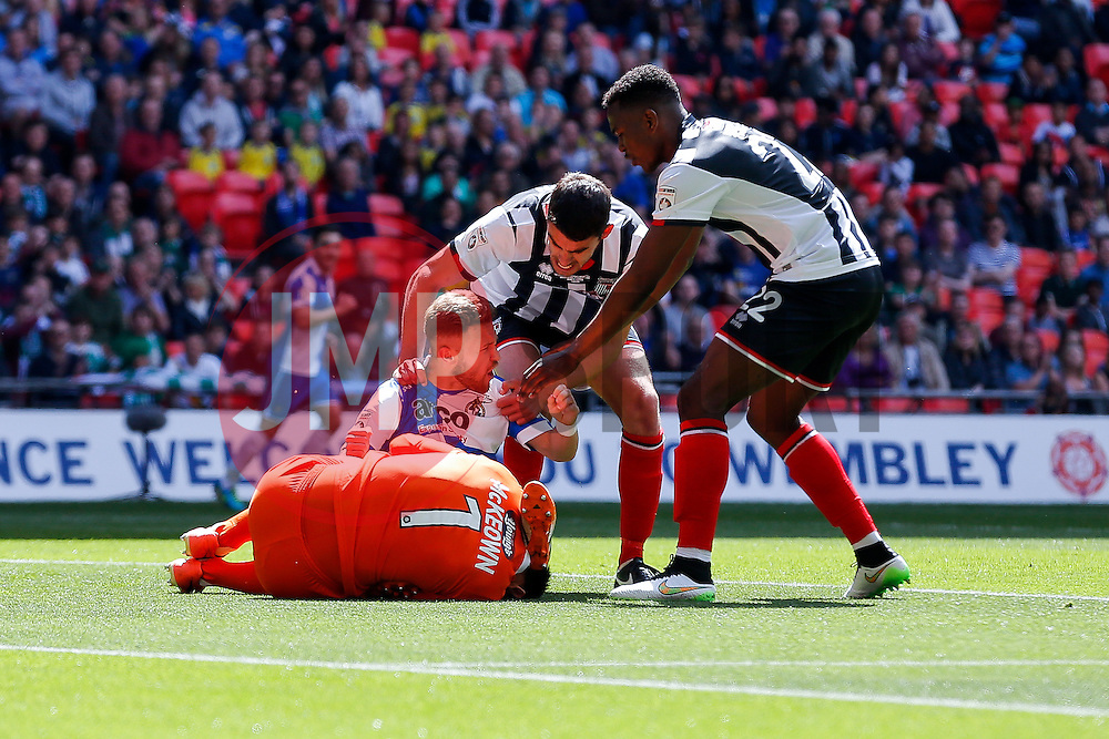 Teammates get involved after Matt Taylor of Bristol Rovers collides with Goalkeeper James McKeown and Shaun Pearson of Grimsby Town - Photo mandatory by-line: Rogan Thomson/JMP - 07966 386802 - 17/05/2015 - SPORT - FOOTBALL - London, England - Wembley Stadium - Bristol Rovers v Frimsby Town - Vanarama Conference Premier Play-off Final.