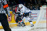 KELOWNA, CANADA - NOVEMBER 20: Ben Walker #10 of the Victoria Royals checks Rourke Chartier #14 of the Kelowna Rockets into the boards on November 20, 2013 at Prospera Place in Kelowna, British Columbia, Canada.   (Photo by Marissa Baecker/Shoot the Breeze)  ***  Local Caption  ***