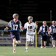 Brodie Merrill #17 of the Boston Cannons and Chris Bocklet #10 of the Denver Outlaws are seen during the game at Harvard Stadium on May 10, 2014 in Boston, Massachusetts. (Photo by Elan Kawesch)