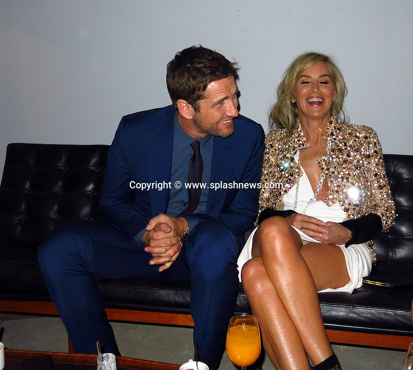 EXCLUSIVE: Ermenegildo Zegna after party at JF Chen Gallery in Hollywood, CA.<br /><br />Pictured: Gerard Butler and Sharon Stone<br />Ref: SPL645944  071113   EXCLUSIVE<br />Picture by: CelebrityVibe / Splash News<br /><br />Splash News and Pictures<br />Los Angeles:310-821-2666<br />New York:212-619-2666<br />London:870-934-2666<br />photodesk@splashnews.com