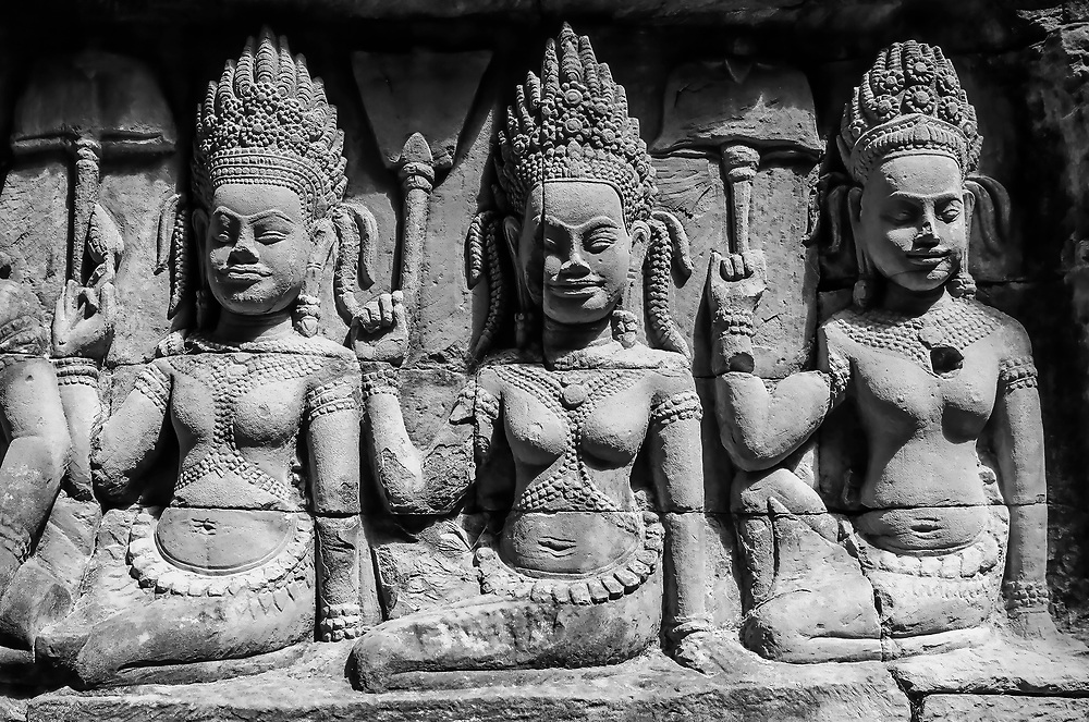 Prayer and Meditation<br /> Three devatas can be seen here seated in religious meditation.