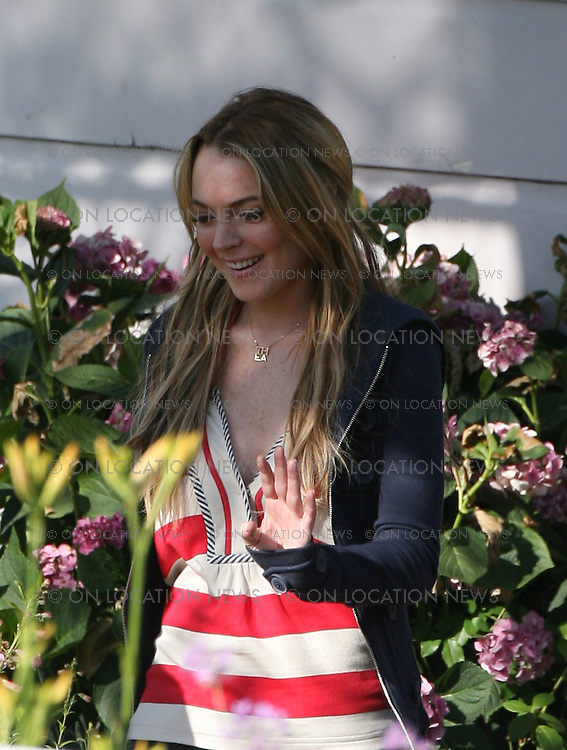 LOS ANGELES, CALIFORNIA - TUESDAY 10TH JUNE 2008 NON EXCLUSIVE: Lindsay Lohan is back to work on her latest movie 'Labor Pains'. For second day in a row  Lohan's 'girlfriend' DJ Samantha Ronson came to visit her on the set. Ronson left alone after giving Lohan a hug goodbye. Photograph: On Location News. Sales: Eric Ford 1/818-613-3955 info@OnLocationNews.com