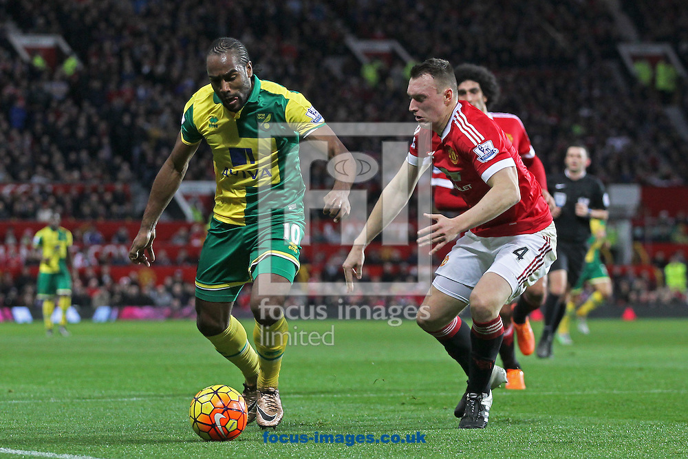 Cameron Jerome of Norwich and Phil Jones of Manchester United in action during the Barclays Premier League match at Old Trafford, Manchester<br /> Picture by Paul Chesterton/Focus Images Ltd +44 7904 640267<br /> 19/12/2015