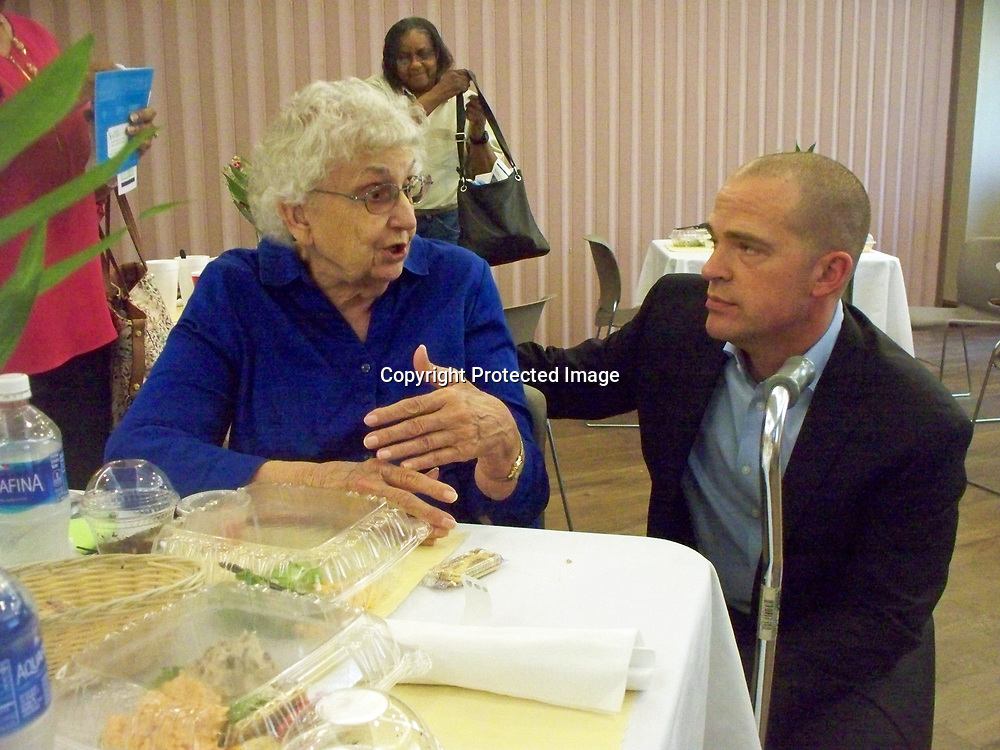 JOHN WARD/BUY AT PHOTOS.MONROECOUNTYJOURNAL.COM<br /> Lois Miller, left, chats with surgeon Dr. Kirk Caddell after a luncheon pertaining to skin cancer at Merit Health Gilmore Memorial. Caddell specializes in breast cancer and melanoma skin cancers.