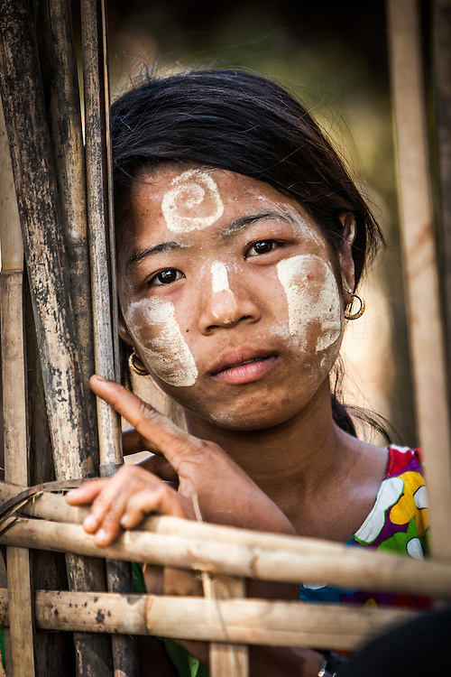 A girl looks into my lens in a small river-side village near Mrauk U, in the Rakhine State of Myanmar. A few Chin tribes are scattered close to the Rakhine-Chin State borders.