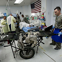 Bagram, Afghanistan: A nurse removes a  dirty litter and ripped clothes of an injured soldier and at the Heath Craig Joint Theatre Hospital at Bagram Airfield. Four US soldier and one civilian were seriously wounded by an IED (improvised explosive device) in theTagab Valley.