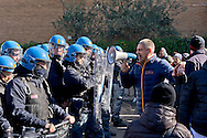 """Rome, Italy. 4th February 2016<br /> Occupied an abandoned building in Via Ostiense by about 200 people  without house, of  Action Rights in motion.Police in riot gear in front  the occupants. Pictured: Andrea Alzetta, said """"Tarzan"""", (megaphone) of Action Rights in motion."""