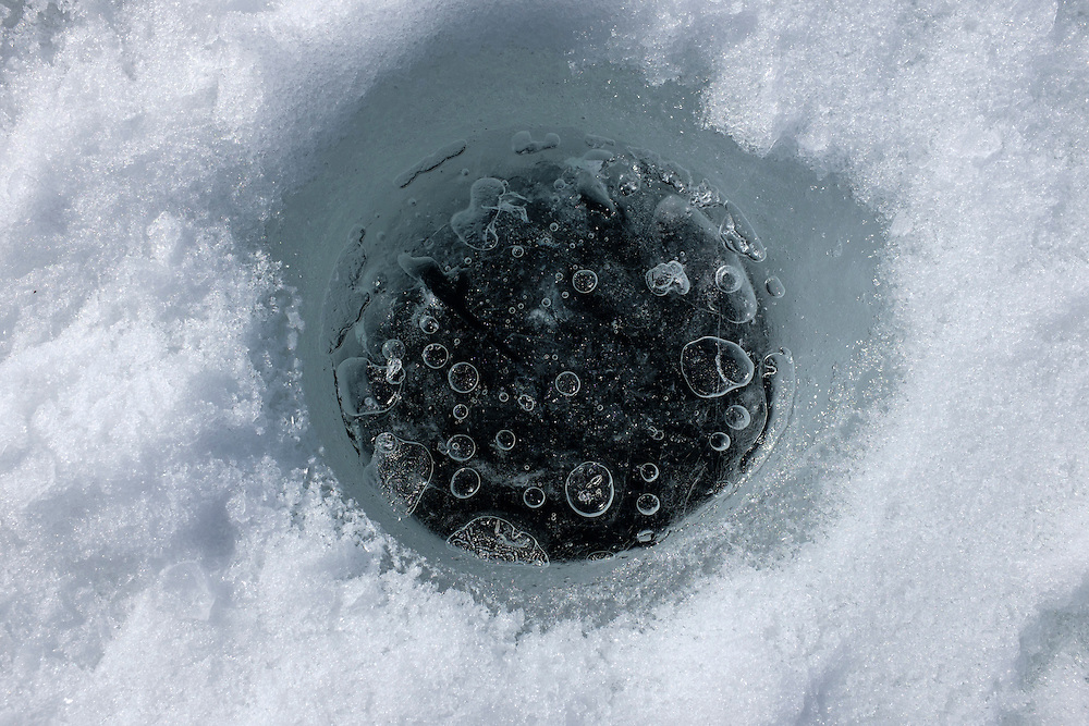 Ice fishing hole frozen over from the previous night, Vallecito reservoir, Southwest Colorado