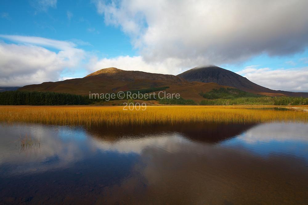 Scotland Isle of Skye  Loch Cill Chriosd looking across to Beinn Dearg Bheag 582mtr  Beinn Dearg Mhor 709mts and Beinn na Caillich 732 mtr