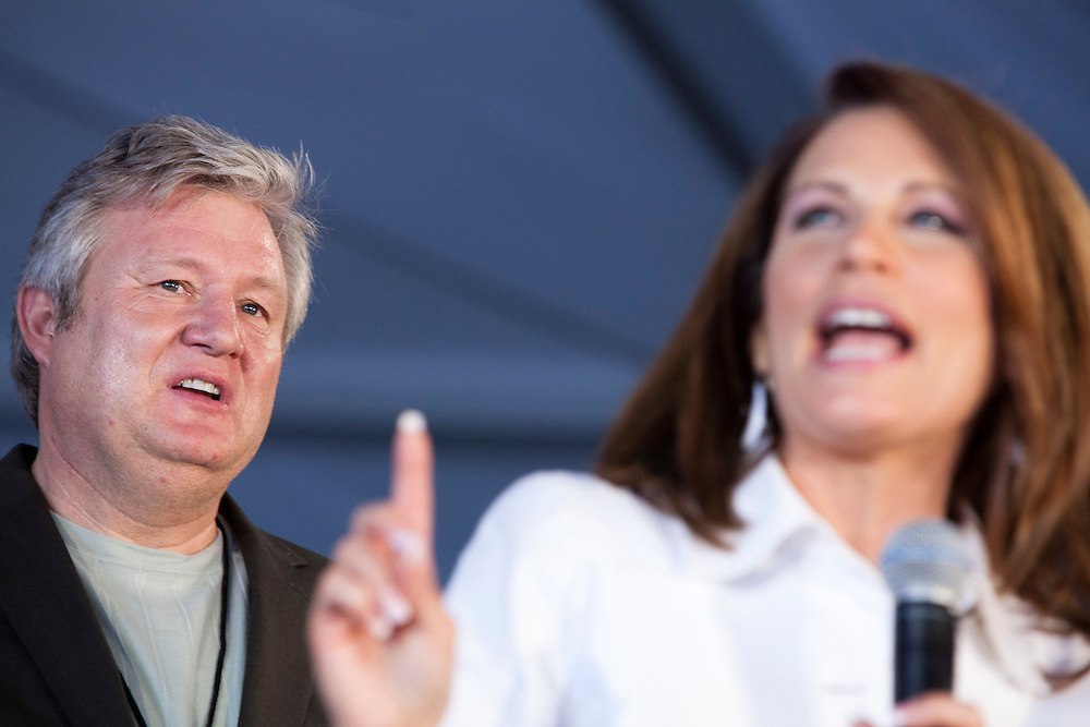Marcus Bachmann listens to his wife, Republican presidential hopeful Michele Bachmann, speak on the stage in her tent at the Iowa Republican Straw Poll on Saturday, August 13, 2011 in Ames, IA.