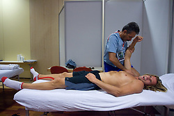 Jure Rovan of Slovenia at physiotherapist Khalid Nasif  in a Team's Hotel Estrel  during day five of the 12th IAAF World Athletics Championships at the Olympic Stadium on August 19, 2009 in Berlin, Germany. (Photo by Vid Ponikvar / Sportida)