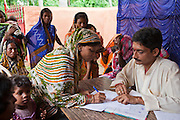 Families from a rural slum in the Orissa district of India get legal advice and birth certificates from a Legal Aid Clinic run by the organisation CLAP. Committee for Legal Aid to Poor (CLAP) is a non-profit organisation helping to provide legal aid to the poorer communities in the Orissa district of India.