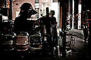 Employee of Chinese tea shop preparing bubble tea to customers, Toronto, Canada