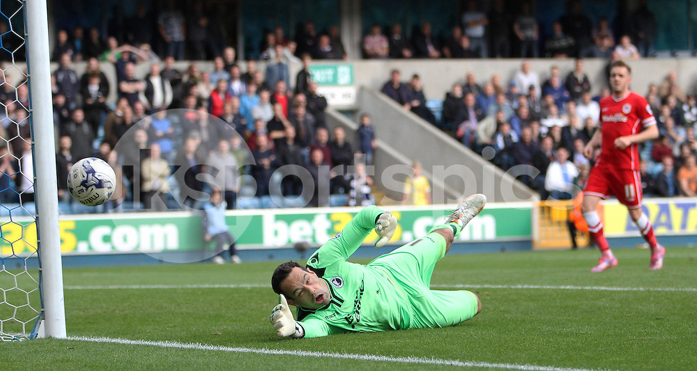 Millwall Goalkeeper David Forde sees the ball go past him wide of the goal during the Sky Bet Championship match between Millwall and Cardiff City at The Den, London, England on 25 October 2014. Photo by Phil Duncan.