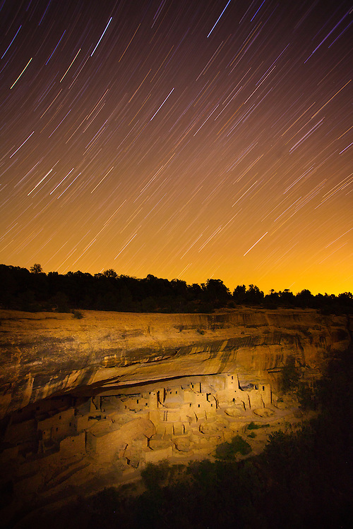 Cliff Palace, one of the most popular alcove sites in Mesa Verde National Park is illuminated during a long exposure photograph emphasizing the paths of stars across the sky. Cliff Palace was built by the Ancestral Puebloans around 800 years ago. Since its rediscovery, it has been visited by millions of tourists over the last 100+ years. This kind of use takes its toll and Cliff Palace was closed this spring for conservation and stabilization projects. It is open again for the summer, but will be closed in fall for more work and reassessment. While The National Park has taken measures including limiting the number of visitors, educating the public on the significance of these places and their need for preservation is key. Created while serving as Artist-In-Residence at Mesa Verde National Park.