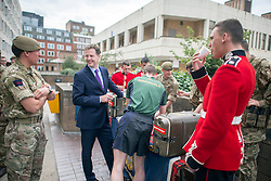 © Licensed to London News Pictures. 26/06/2014. London, UK The Deputy Prime Minister, NICK CLEGG, accompanied by ALISTAIR CARMICHAEL the Secretary of State for Scotland visit F Company, part of the Scots Guards, at Wellington Barracks in London on Thursday 26 June to mark Armed Forces Day 2014. On the visit, they met the Guardmen in their line up, saw a weapons test and chatted to them as they prepared their kit ahead of going on exercise, They also saw Guardsmen preparing for the ceremonial side of their duties as The Queen's Guards.. Photo credit : Stephen Simpson/LNP