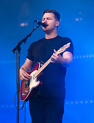 © Licensed to London News Pictures. 28/08/2015. Reading Festival, UK.  Alt J performing at Reading Festival 2015 28 August 2015 Day 1.  In this picture - Joe Newman. Photo credit: Richard Isaac/LNP